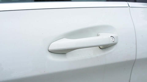 Female's hand opens modern white car door by grabbing its handle Live Action