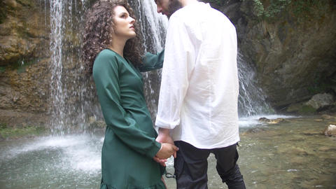 beautiful couple in love man and woman hold hands and look at each other against Footage