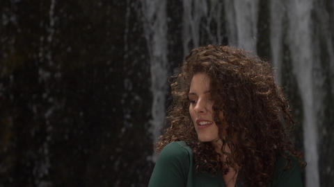 portrait of a beautiful young woman with curly hair on the background of a Footage