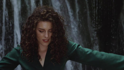 Close up of a sexy young woman with curly hair enjoying the freshness of a Footage
