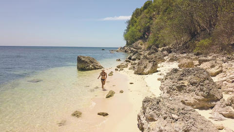 Happy young woman running on sea at sandy beach on tropical island at sunny day Footage