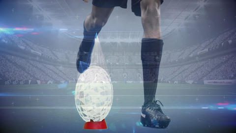 Rugby player kicking football with animated glass shards coming off the ball in full stadium Animation