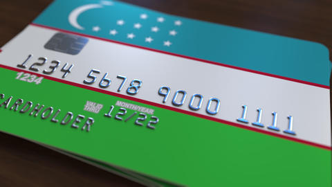 Plastic bank card featuring flag of Uzbekistan. Uzbek national banking system Footage