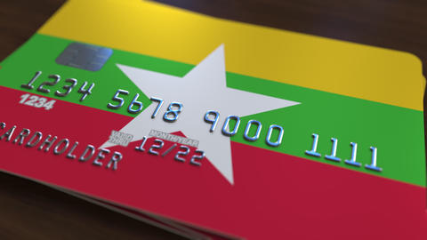 Bank card featuring flag of Myanmar. Myanma national banking system related Footage