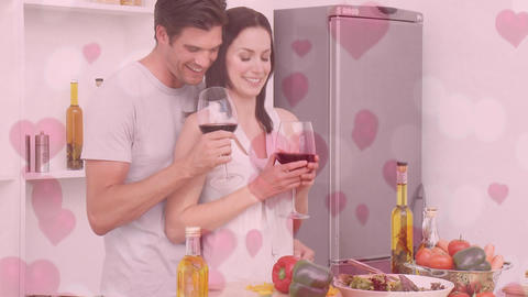Couple preparing dinner while drinking red wine Animation