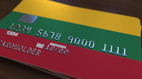Plastic bank card featuring flag of Lithuania. Lithuanian national banking Footage