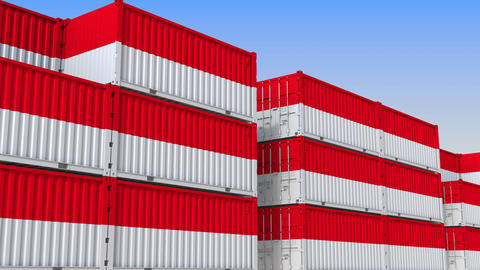 Container terminal full of containers with flag of Indonesia. Indonesian export Live Action