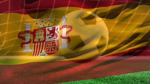 Soccer ball bouncing on grass while Spanish flag waves on the foreground on soccer field Animation