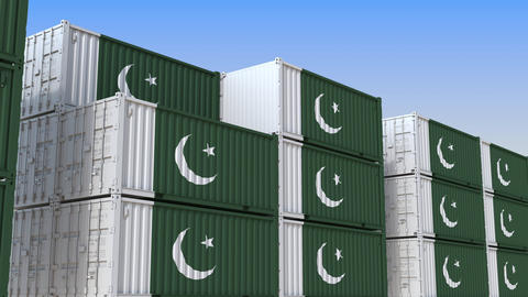 Container terminal full of containers with flag of Pakistan. Pakistani export or Live Action