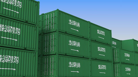 Container terminal full of containers with flag of Saudi Arabia. Export or Live Action