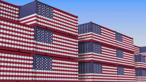 Container terminal full of containers with flag of the USA. American export or Live Action