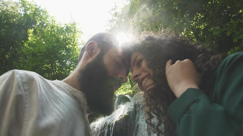 young and beautiful man and woman bowed to one another in bright sunlight and Footage