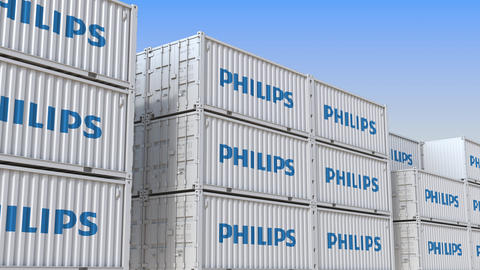 Container terminal full of containers with logo of Philips. Shipment, export or Live Action