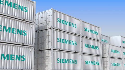 Container terminal full of containers with logo of Siemens. Shipment, export or Live Action