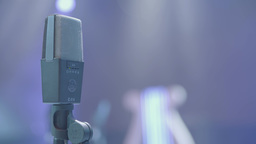Professional microphone for recording audio on stage, in the light. Close-up Footage