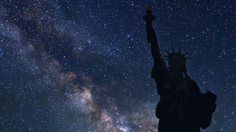 statue of liberty in silhouette with time lapse of stars Footage