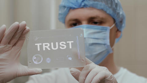 Doctor uses tablet with text Trust Footage