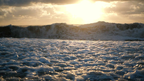 The awful Black Sea with stormy waves at wild sunset in summer in slow motion Live Action