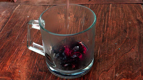 Hibiscus tea or Sudan rose herbal roselle brewing. Dried calyces as leaves and flowers are brewed in Live Action