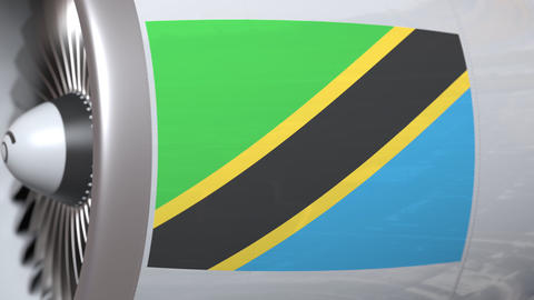 National flag of Tanzania on airplane tourbine engine. Aviation related 3D Footage