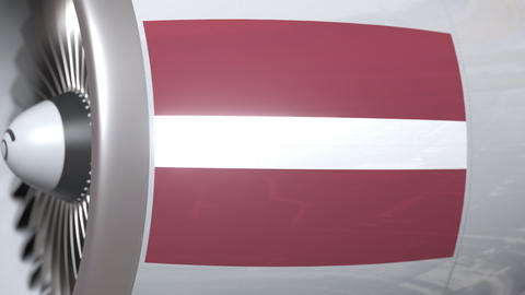 Waving flag of Latvia on airliner tourbine engine. Aviation related 3D animation Footage
