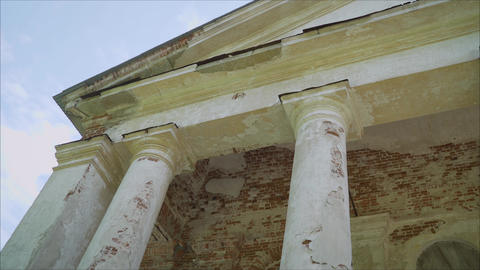 Beautiful old-fashioned old building with tall columns. Detail of a building Live Action