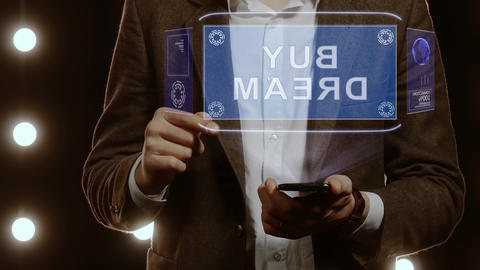 Businessman shows hologram with text Buy dream Footage