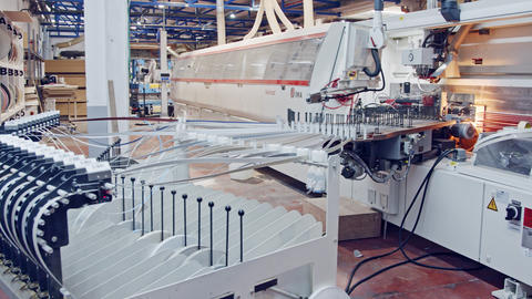 Machines in a furniture manufacturing facility Footage