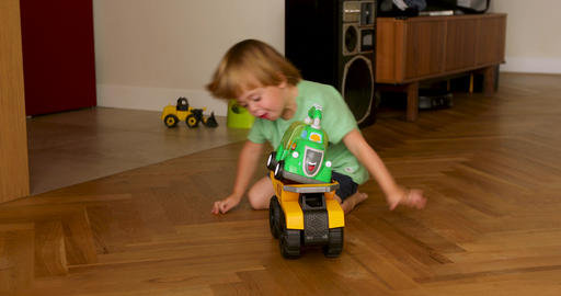 Child playing with machine on wooden floor Live Action