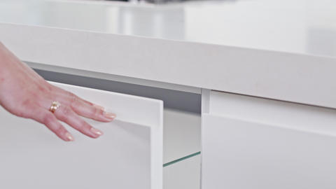 Close up of a white modern luxury kitchen drawer closing slowly Footage