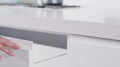 Close up of a white modern luxury kitchen drawer closing slowly Live Action