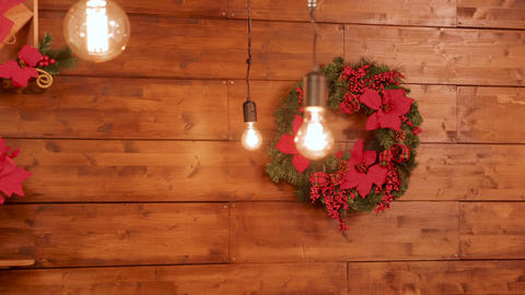 Christmas garlands on wooden wall Footage