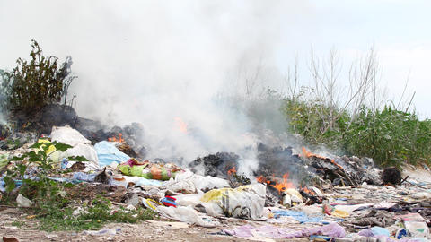 Fire at the garbage dump. Burning garbage, ecology in danger Footage