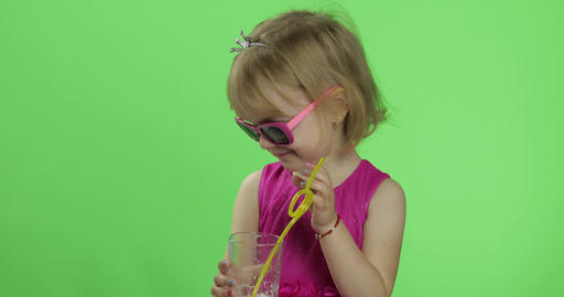 Happy four years old child in pink dress drinks milkshake… Stock Video Footage