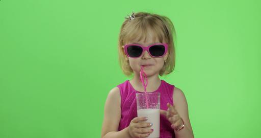 Happy four years old child in pink dress drinks milkshake… Stock Video Footage
