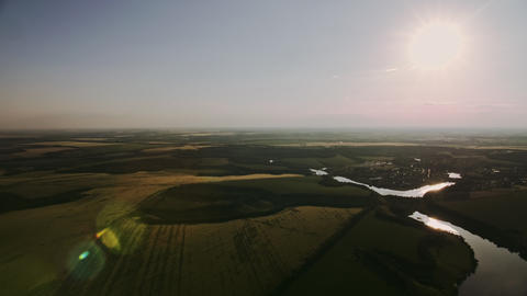 Aerial Evening Sunshine View Of Field and trees Live Action