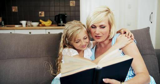Mother Reading Book to Daughter Live Action