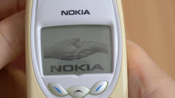 Switching On an old Nokia mobile phone. Famous start animation ビデオ