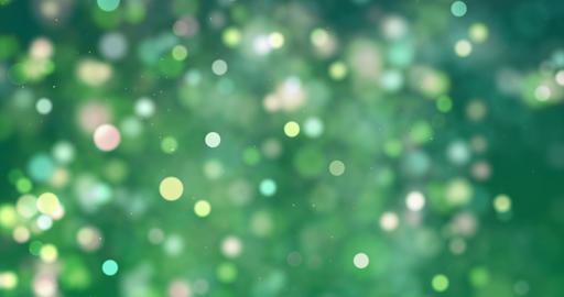 christmas digital glitter sparks green yellow color particles bokeh flowing on green background, Live Action