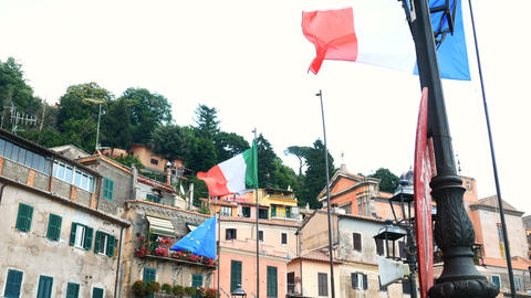 flags of Italy and Europe waving in Nemi, Rome province Footage