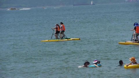 People play water bike toys on sea Stock Video Footage