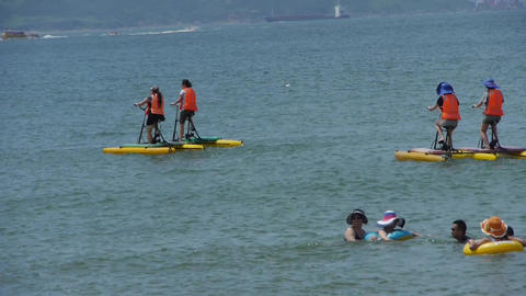 People play water bike toys on sea Footage
