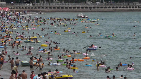 Many people swim in sea.swimming pool.Vehicles car in... Stock Video Footage