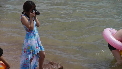 female photographer taking pictures.Female model to... Stock Video Footage