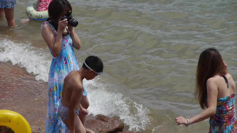 female photographer taking pictures.Female model to pose.tide,tidal Footage
