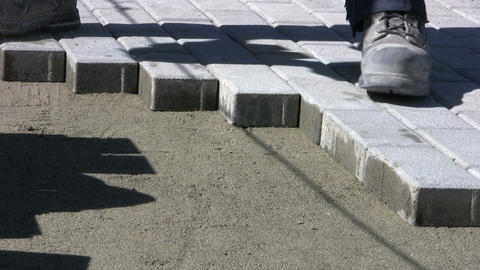 Installing Sidewalk Bricks Stock Video Footage