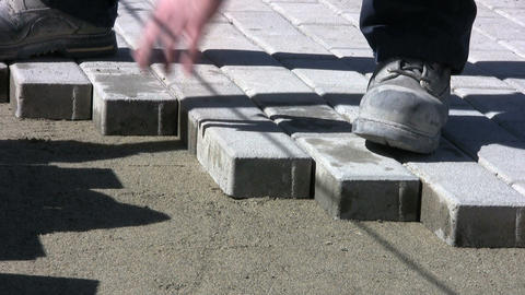 Installing Sidewalk Bricks Stock Video Footage