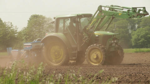 Tractor working in the fields Stock Video Footage