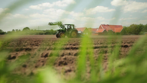 Tractor Sowing On Ploughed Agricultural Field stock footage