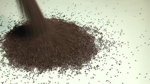 Pouring poppy seeds Stock Video Footage